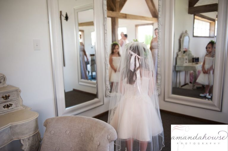 Flower Girl Wearing Bride's Veil in Bridal Suite at Genesis Farm and Gardens Wedding Venue in Enumclaw Photographed by Amanda Howse