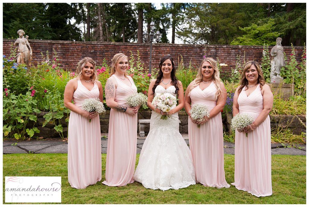 Bride and bridal party smiling for portraits photographed by Tacoma Wedding Photographer Amanda Howse